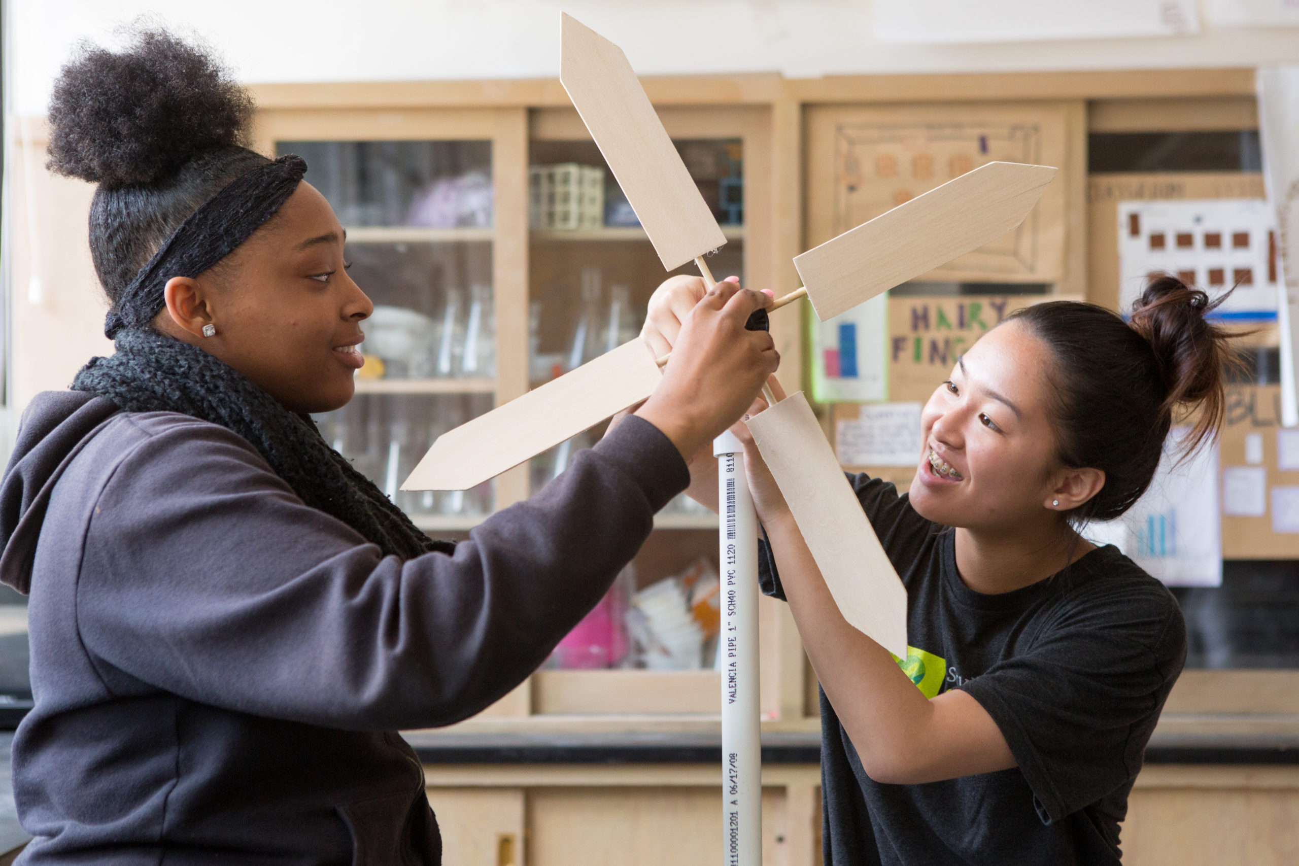 Students assemble a model wind turbine they constructed.